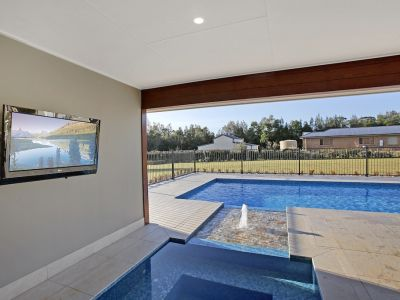 Wall mounted TV in alfresco area